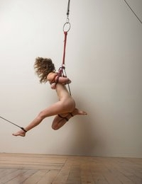 Here's the conclusion of Helena's first suspension session against the studio wall.