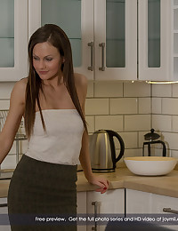 Tina Kay is home, expecting her boyfriend's soon arrival. She's supposed to have dinner for him, but she can't think of anything to make. So when he walks in hungry, she has to think fast, and offers him the best meal there is - fresh wet pussy. After he eats her out right on the table, it's her turn for an appetizer, as she munches down deep on his hard hot shaft. Then it's time for the main course - a stiff long fucking on the counter, with as many positions as there are items on a well-laid plate. This sexy little lady has such a great time getting boned in the kitchen, she smiles as much as she cums, and her man delivers the dessert - a warm cream pie - right into her open shaved love cup. A family that sups together stays together!
