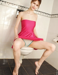 Hot babe Beata strips nice and easy in the bathroom