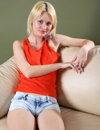 Blonde babe Marta in red top in couch showing her small tits and pussy